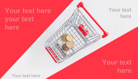 Coins in the shopping cart Stock Images