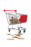 Coins in shopping cart Stock Photo