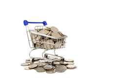 Coins in shopping cart Royalty Free Stock Photography