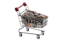 Coins in a shopping cart on a white background. (USD). US Dollar coins in a shopping cart, with a red handle on a white isolated background Royalty Free Stock Images