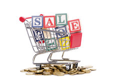 Coins, shopping cart and word SALE. The coins, shopping cart and word SALE on white Stock Photo