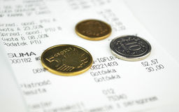 Coins and a Shopping Receipt Stock Photos