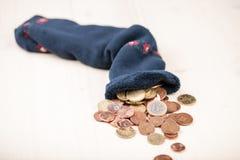 Coins in sock Stock Photos