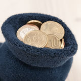 Coins in sock Stock Photo