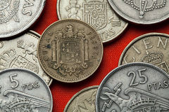 Coins of Spain. Spanish state emblem under Franco. Coins of Spain. Coat of arms of Spain under Franco depicted in the Spanish one peseta coin (1966 royalty free stock photos