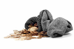 Coins Spill From Wool Sock Stock Image