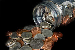 Free Coins Spilled From A Mason Jar On Black Background Royalty Free Stock Photo - 83566555