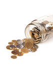 Coins Spilled From Jar Royalty Free Stock Photos