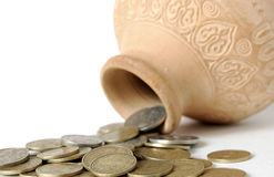 Coins Spilling from a container Royalty Free Stock Images