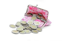 Coins spilling from money bag Royalty Free Stock Image