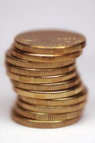 Coins in Stack. Stack of gold tinted coins. Australian 1 dollar coins. White background stock photography