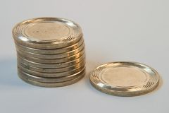 Coins in a stack. Ten coins and nine of them in a stack with one of them on the side - can illustrate on tenth, as in tithing Royalty Free Stock Image