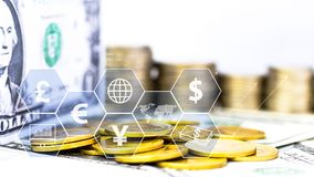 Coins stack and banknote with icon virtual on the table. The concept of business growth, financial or world trade.  stock photos