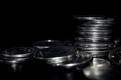 Coins on a black background royalty free stock photos