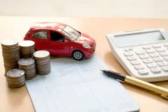 Coins stack in columns, saving book, car. Finance and banking co Stock Photography