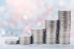 Coins stack in front of bank account book Savings money royalty free stock image