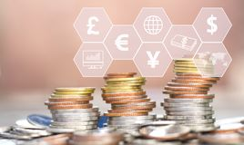 Coins stack with icon virtual on the table. The concept of business growth, financial or world trade.  stock photo
