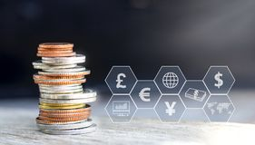 Coins stack with icon virtual on the table. The concept of business growth, financial or world trade.  royalty free stock photos