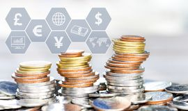 Coins stack with icon virtual on the table. The concept of business growth, financial or world trade stock image
