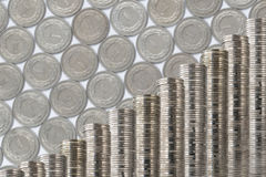 Coins stack slanted on coins background. Rows of coin stacks on coins background one polish zloty. Slanted  decoration with money Royalty Free Stock Images