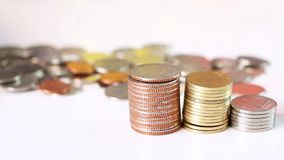 Coins stack on white table. The concept of business growth, financial or money savings stock footage