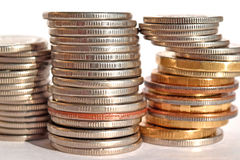 Coins stacked in bars. Stock Photos