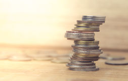Coins stacked on each other in different positions. Royalty Free Stock Photography