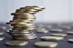 Coins stacked on each other in different positions. royalty free stock image