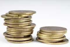 Coins stacked. Money lying on the table. White background Stock Photography