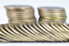 Coins stacked. Money lying on the table. White background Royalty Free Stock Photos