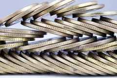 Coins stacked. Money lying on the table. White background Royalty Free Stock Photography