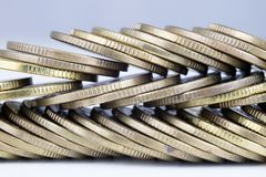 Coins stacked. Money lying on the table. White background Stock Images