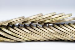 Coins stacked. Money lying on the table. White background Stock Photos