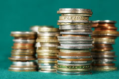 Coins stacked in piles Royalty Free Stock Photos
