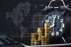 Coins stacks and alarm clock with tablet computer and financial graph, business planning vision and finance analysis, world map,. Global network business stock photos