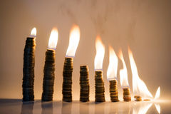 Coins statistic fire Stock Photo