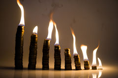 Coins statistic fire Stock Photography