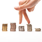 Coins stock. Walking fingers on the top of the coins stocks Stock Photos