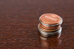 Coins on table Stock Photos