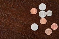 Coins on table stock photos
