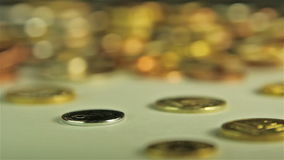 Coins on the table. Close up, follow focus shot stock footage