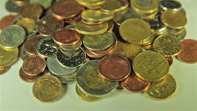 Coins on the table. Close up, rotation shot stock footage
