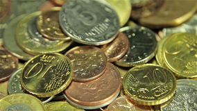 Coins on the table. Close up, slider shot stock footage
