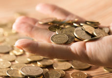 Coins on the table and in hand Royalty Free Stock Photo