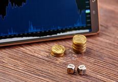 Coins, tablet, dices cubes, financial chart Royalty Free Stock Photo
