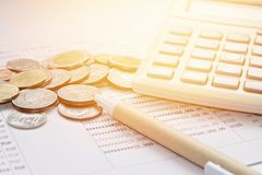 Coins, Thai Money, Pen, Calculator And Savings Account Passbook On White Background Stock Photography