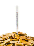 Coins and thermometer Stock Photo