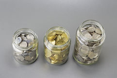 Coins in The Three Different Size of Jar - Financial Concept Royalty Free Stock Photography