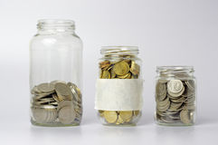 Coins in The Three Different Size of Jar - Financial Concept Royalty Free Stock Images