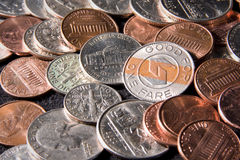Coins and a Token Stock Photography